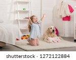 happy adorable kid standing on... | Shutterstock . vector #1272122884