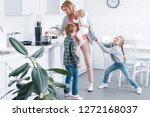 tired mother holding infant... | Shutterstock . vector #1272168037