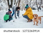 family with a small yellow dog...   Shutterstock . vector #1272263914