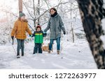family with small yellow dog...   Shutterstock . vector #1272263977