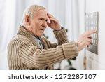 Senior Man Looking At Wall...