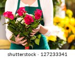 florist hands showing red roses ... | Shutterstock . vector #127233341