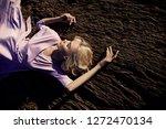 blonde woman in a long pink...   Shutterstock . vector #1272470134