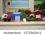 Red And Blue Honesty Box In A...
