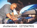 driver on the road having... | Shutterstock . vector #1272567931