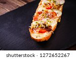 open faced toasted cheese... | Shutterstock . vector #1272652267