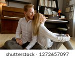 happy and loving young couple... | Shutterstock . vector #1272657097