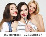 beauty girls with a microphone... | Shutterstock . vector #1272688687