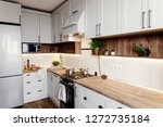 stylish kitchen interior design.... | Shutterstock . vector #1272735184