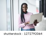 young afro american woman... | Shutterstock . vector #1272792064