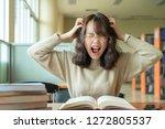 unhappy asian woman boring to... | Shutterstock . vector #1272805537