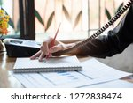 young business woman sitting at ...   Shutterstock . vector #1272838474