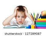 sad schoolboy doing is homework.... | Shutterstock . vector #127289087