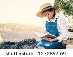 asian girl reading a book... | Shutterstock . vector #1272892591