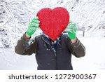 man holding a valentine heart...   Shutterstock . vector #1272900367