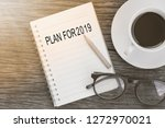 plan for 2019 word on notebook... | Shutterstock . vector #1272970021
