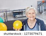 happy senior woman with ball in ... | Shutterstock . vector #1273079671
