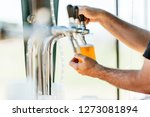 man serving draft beer in a... | Shutterstock . vector #1273081894