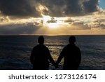 romantic couple  sundown sea   Shutterstock . vector #1273126174