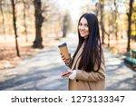 fall woman drinking coffee in...   Shutterstock . vector #1273133347