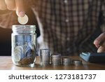 business man putting coin in... | Shutterstock . vector #1273181737