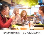 happy asian young group  eating ...   Shutterstock . vector #1273206244