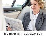 mature businesswoman reading...   Shutterstock . vector #1273234624