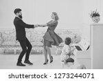 rich parents enjoy parenthood.... | Shutterstock . vector #1273244071