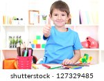 cute little boy drawing in his... | Shutterstock . vector #127329485