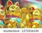 Stock photo chinese lucky wealth waving cat 1273316134
