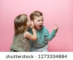 stylish little girl whispering... | Shutterstock . vector #1273334884