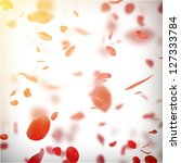 Stock photo valentine background with falling red rose petals 127333784