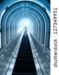 Contemporary blue moving escalator - stock photo