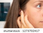 a caucasian woman pressing on... | Shutterstock . vector #1273702417