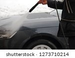 a man washes the dirt and salt... | Shutterstock . vector #1273710214