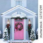 holiday decorated front entrance to home - stock photo