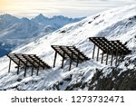 Small photo of Avalanche control or defense in the alps Europe ski area. Engineered solutions for preventing major avalanches and conditions that lead to avalanches or interrupting the flow of snow.