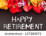 Bunch of tulips with blackboard: happy retirement - stock photo