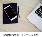 phone on notebook with pen and... | Shutterstock . vector #1274012524