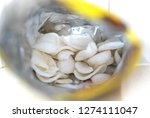 bag with prawn crackers  open | Shutterstock . vector #1274111047