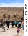 JERUSALEM, ISRAEL - APRIL 12: Panoramic view on the Wailing Wall (women part) - pilgrims and tourists during the Jewish Pesach (Passover) celebration on April 12, 2012 in Jerusalem, Israel. - stock photo