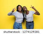 two happy pretty pretty african ...   Shutterstock . vector #1274129281