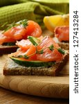 canape sandwiches with salmon... | Shutterstock . vector #127413284