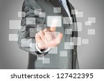 Businessman with hand using virtual inteface - stock photo
