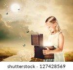 Happy Blonde Girl Opening a Treasure Box - stock photo