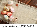 painted colored easter eggs on... | Shutterstock . vector #1274286127