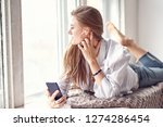 young beautiful woman listens... | Shutterstock . vector #1274286454