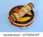 """Small photo of Close-up of two colorful handmade Brazilian percussion instruments: pandeiro (tambourine) and """"ganzá"""", a type of rattle. They are widely used to accompany the samba music."""