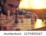 the young man looks at a... | Shutterstock . vector #1274305267