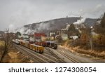 a railroad in a small town with ... | Shutterstock . vector #1274308054
